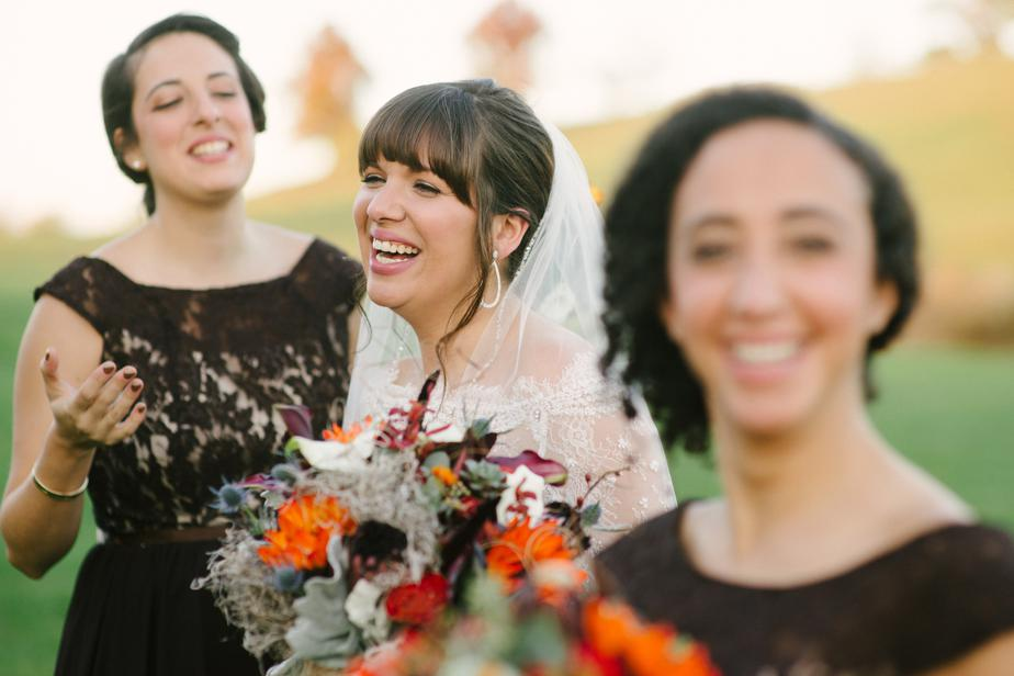 bride laughs at barn at gibbet hill wedding