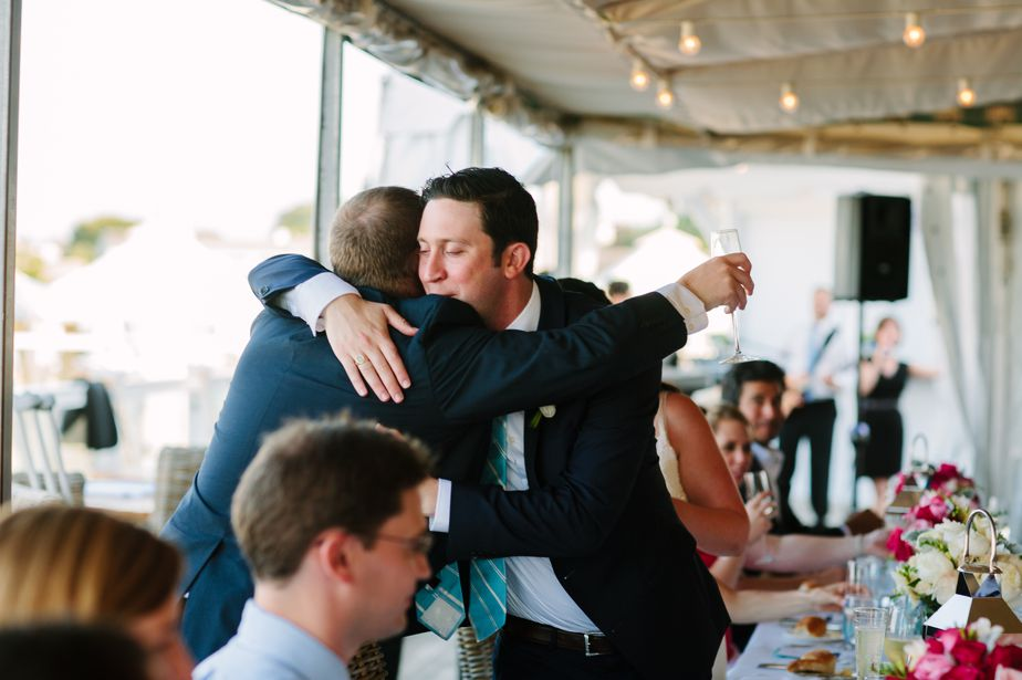 chatham bars inn wedding groom hugs best man