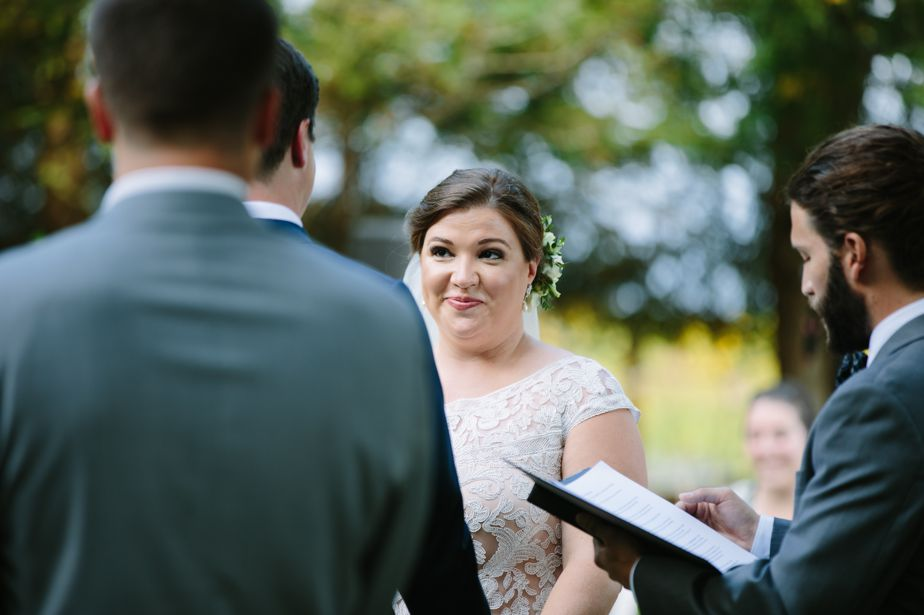 bride looks at groom during ceremony