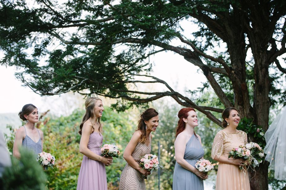 bridesmaids laugh at ceremony