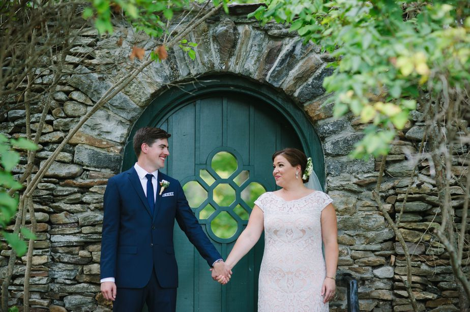 green door bride and groom at garden wedding