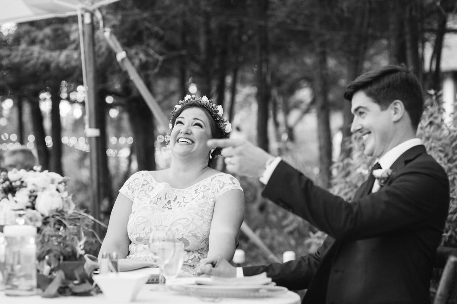 bride and groom laugh at toasts at brookwood garden wedding