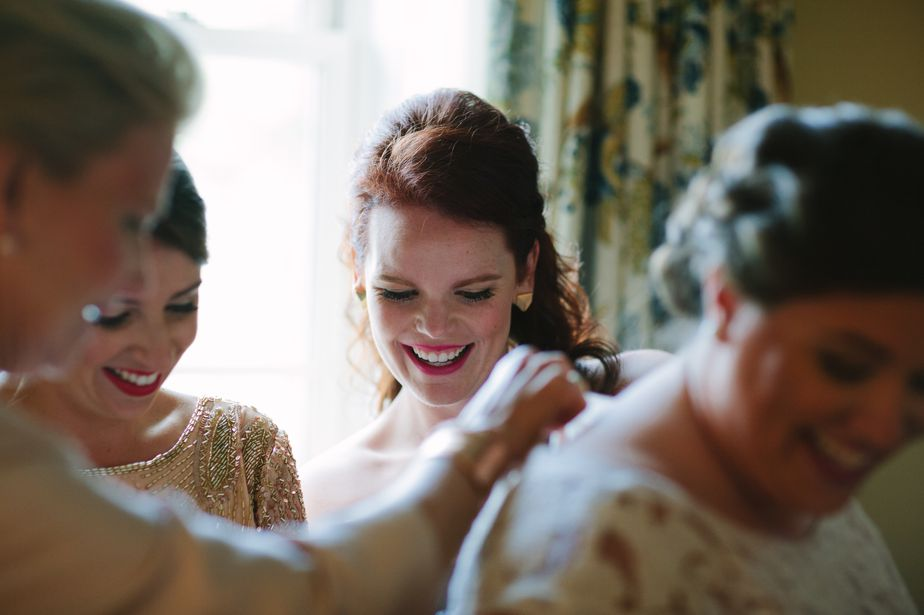 bridesmaid helping with dress otesaga hotel