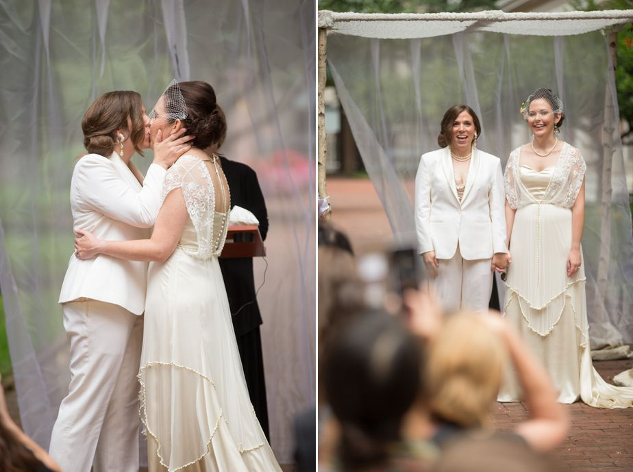 lesbian wedding kiss at outdoor ceremony in Cambridge MA CMAC