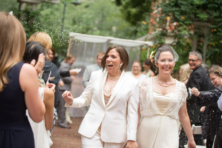 two brides get married at cambridge multicultural arts center