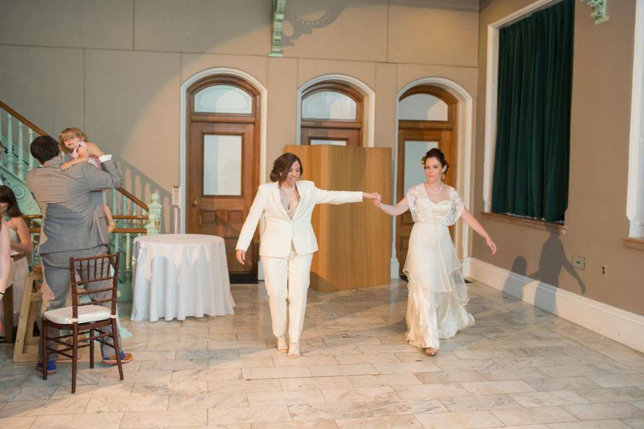 two bride enter reception at CMAC wedding in cambridge MA