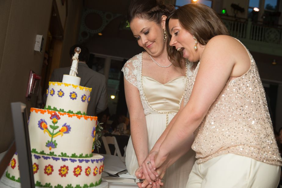two brides cut cake at gay wedding in cambridge ma