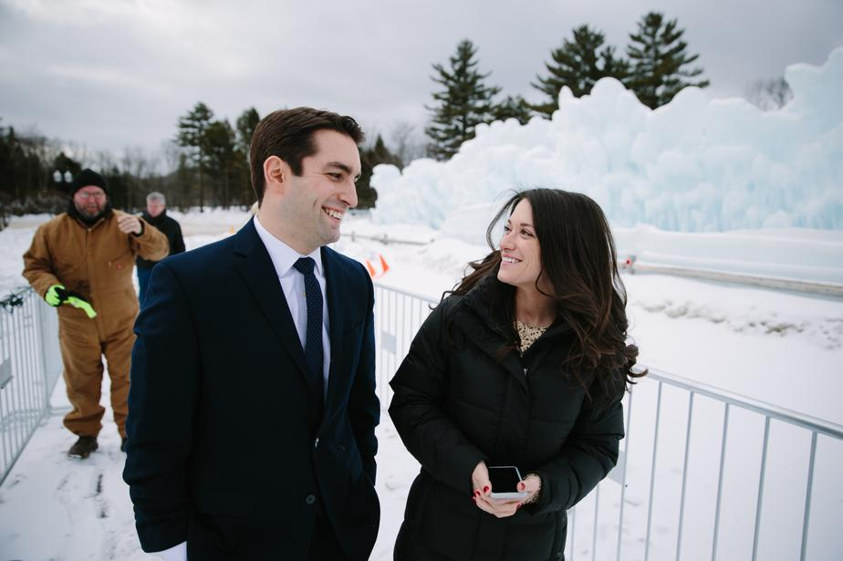 bride and groom get ready for portraits in the NH ice castles