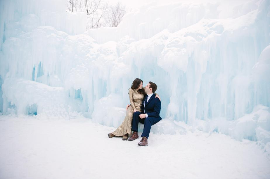 bride and groom snuggle in the ice castles in NH