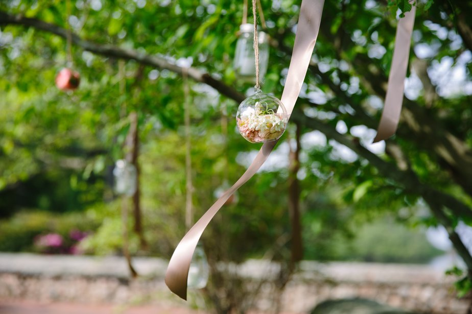 orbs of flowers in trees at moraine farm wedding