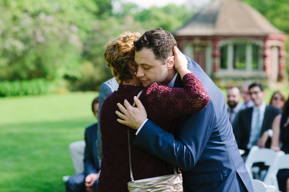 groom hugs mom at moraine farm wedding