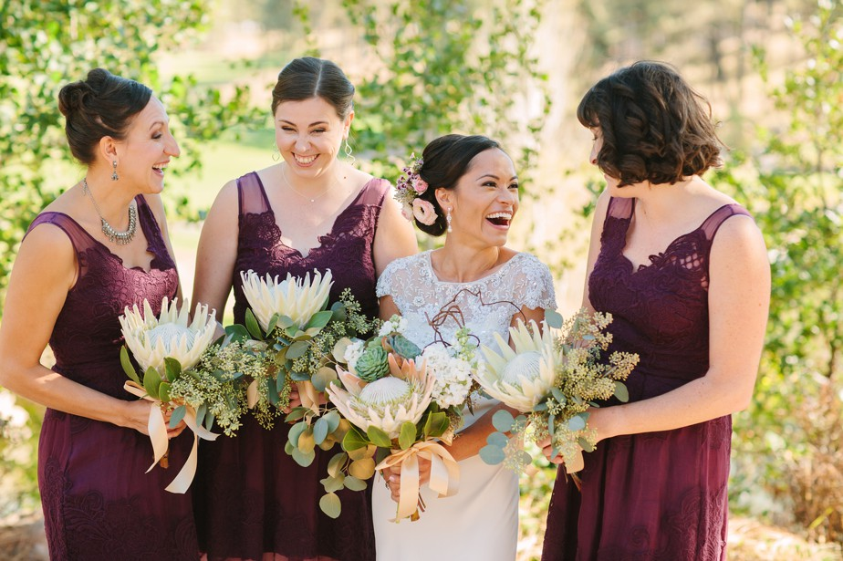 merlot bridesmaid dresses and protea wedding bouquet