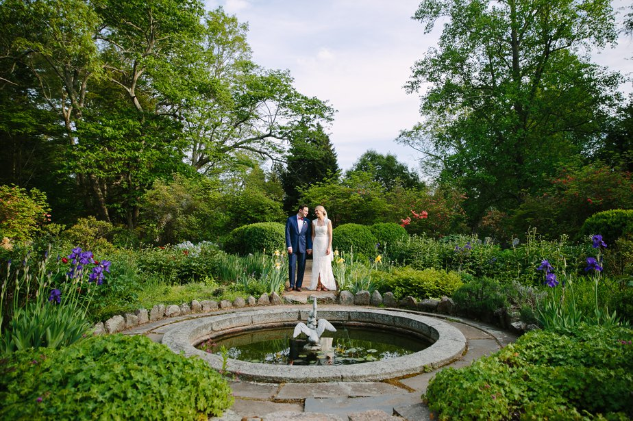 couple by fountain at the estate at moraine farm in beverly