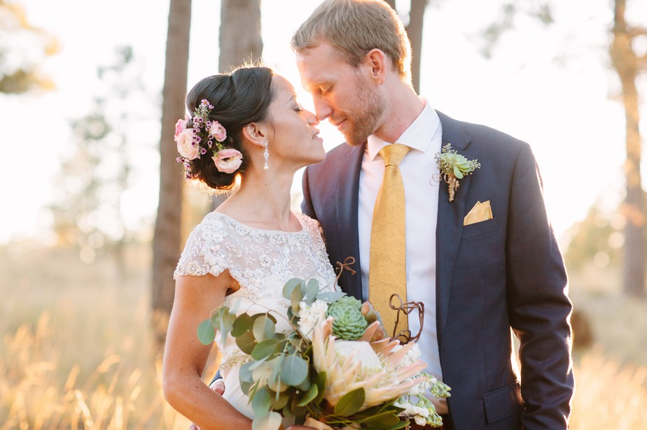 flowers in bride's hair and protea bouquet for this destination wedding in Arizona