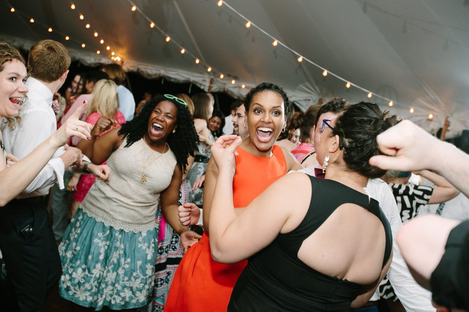 guests dancing at tented reception at The Estate at Moraine Farm in Beverly MA