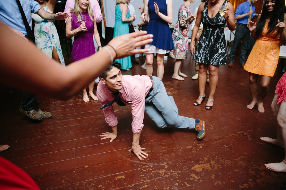 break dancing at tented reception at The Estate at Moraine Farm in Beverly MA