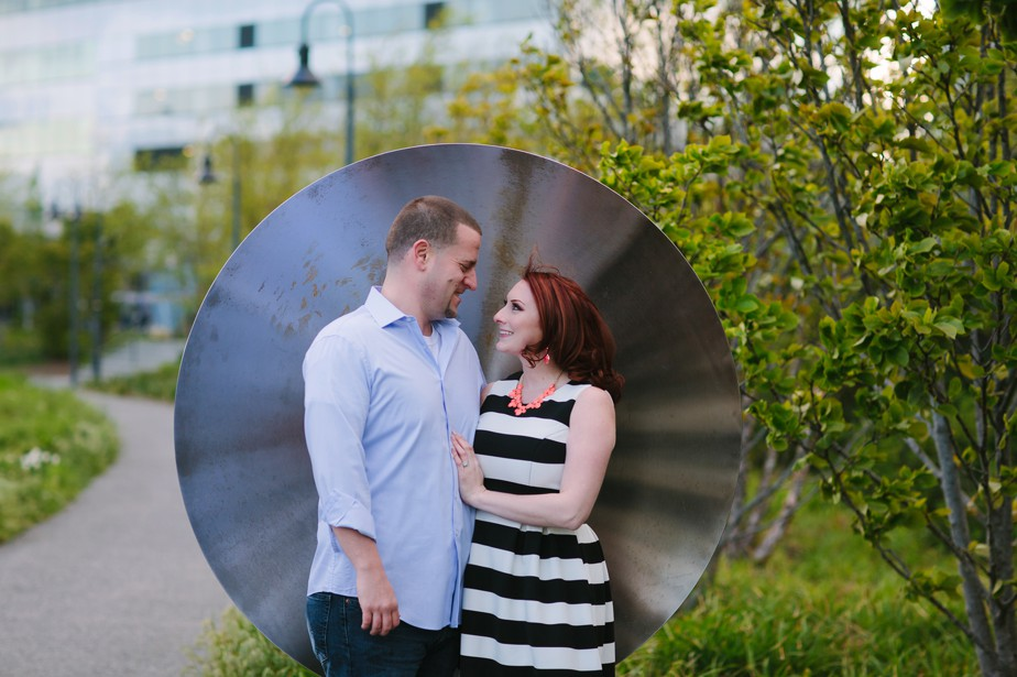 using sculpture to frame this couple at north point park engagment shoot by studio nouveau