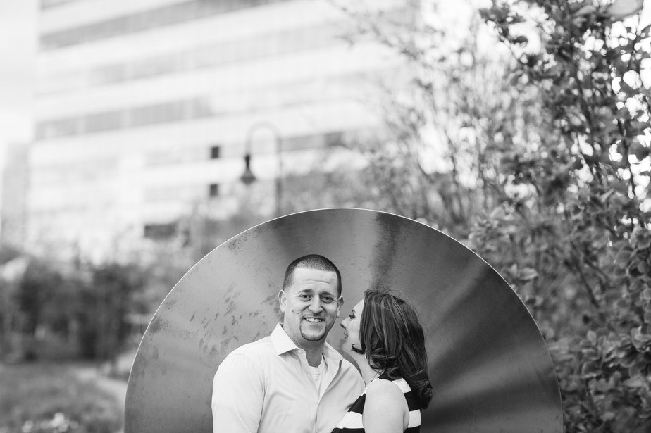sweet couple in a sculpture at north point park engagment shoot by studio nouveau
