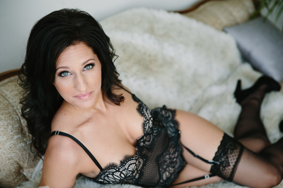 black llingerie and fur blanket for boston boudoir session