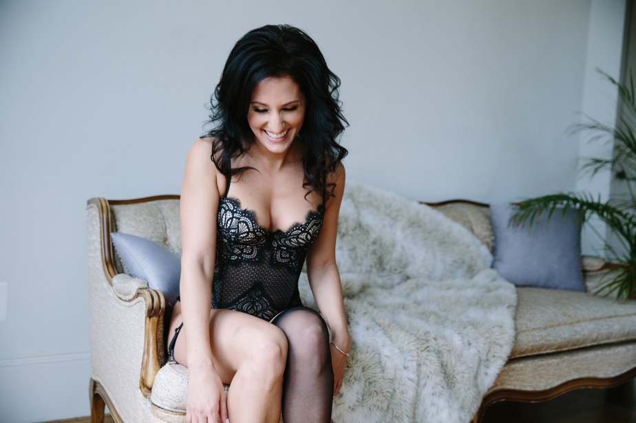 laughing and looking natural in boston boudoir studio