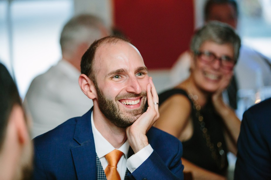 groom smiles at toasts at his dorset inn wedding in vermont