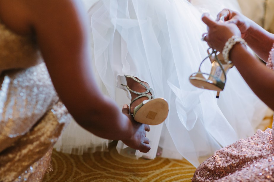 shoes go on in boston harbor wedding
