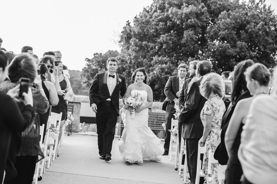 bride comes down aisle with dad at pilgrim monument wedding provincetown Ptown