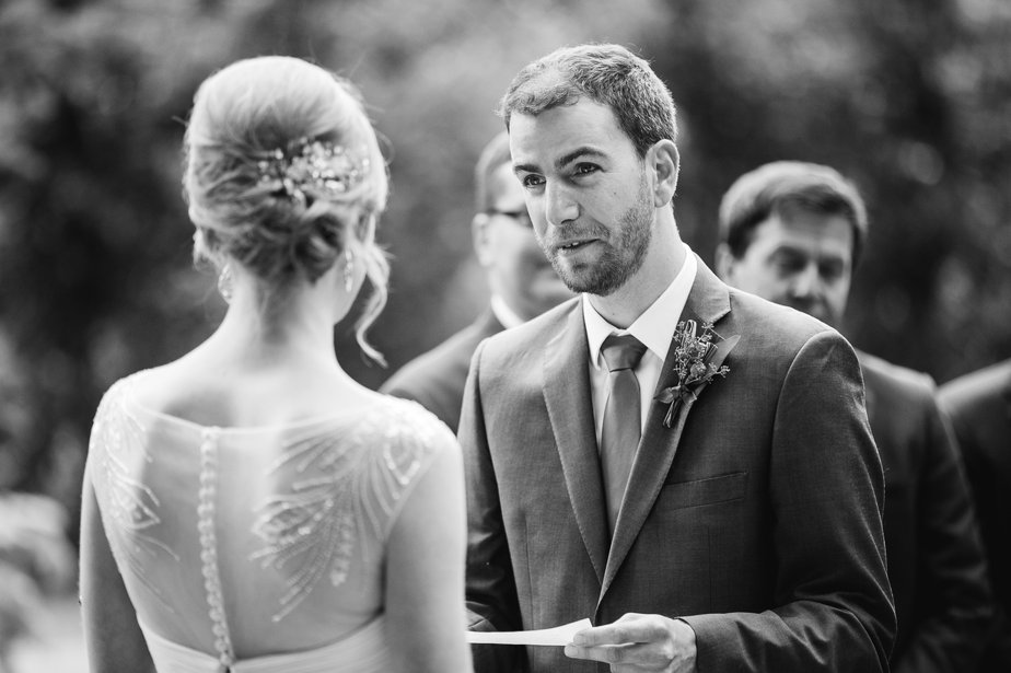 groom says vows at outdoor ceremony at garden wedding oregon