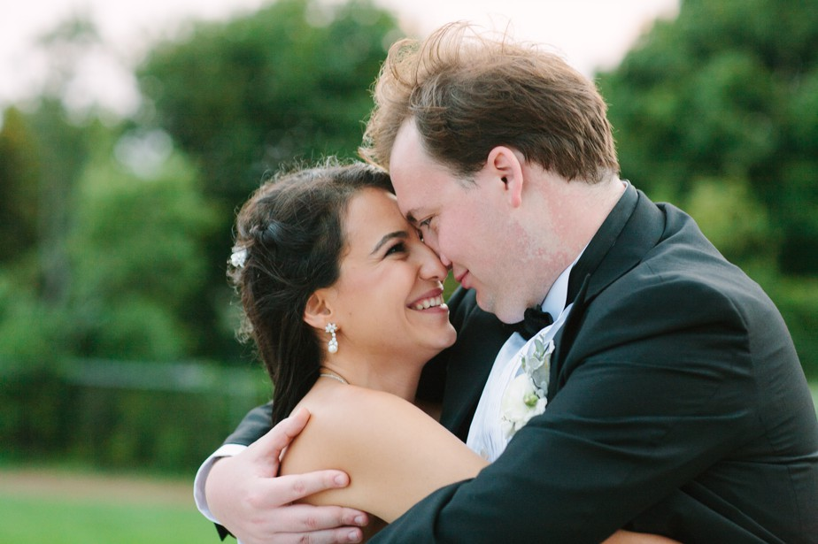snuggly couple at pilgrim monument wedding provincetown Ptown