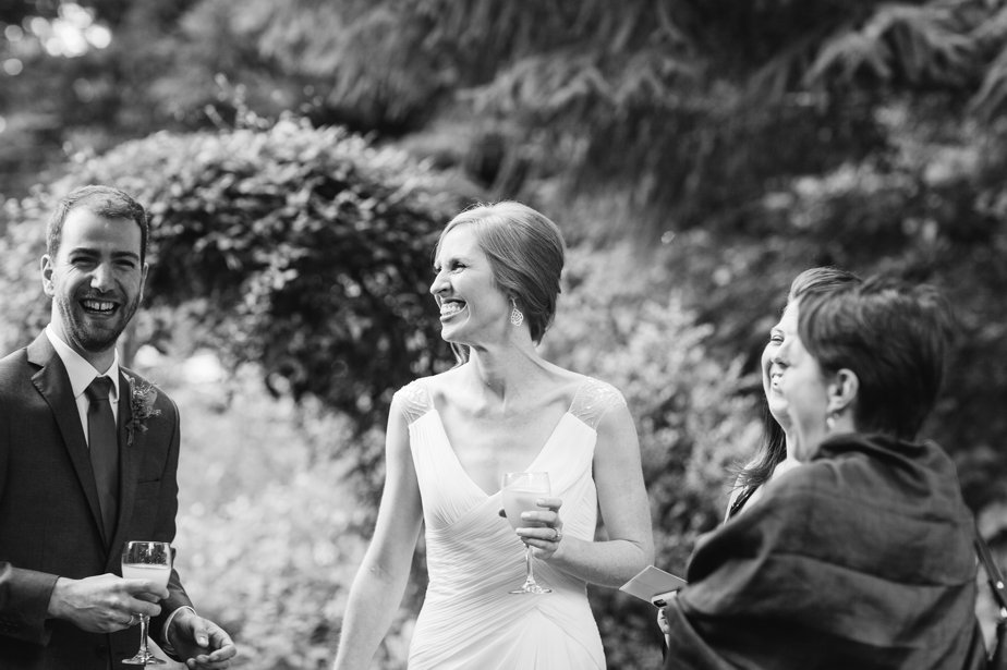 bride laughing at cocktail hour at mt hood organic farm