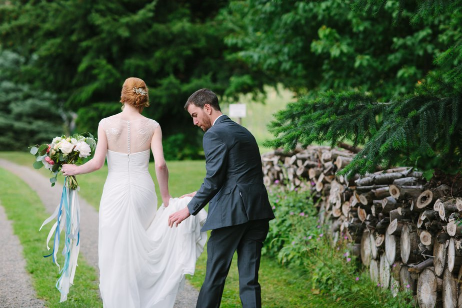 groom helps bride at mt hood organic farm