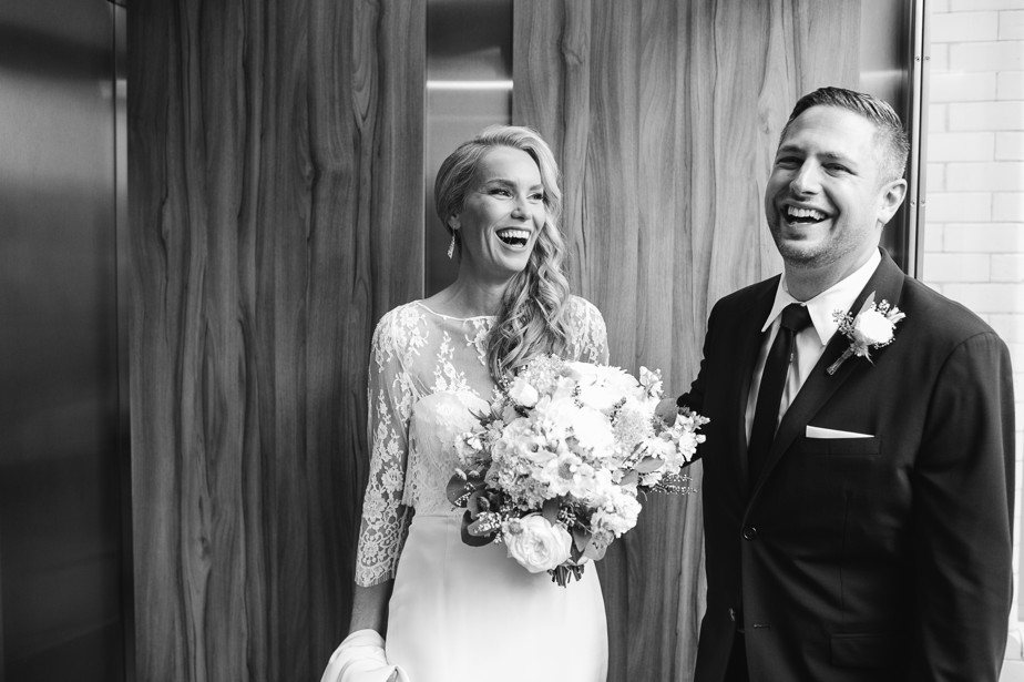 bride and groom laugh in elevator before rooftop ceremony at coppersmith boston restaurant wedding