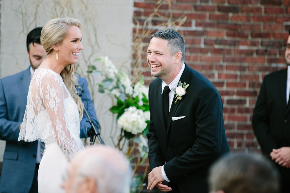 groom laughs rooftop ceremony at coppersmith boston restaurant wedding