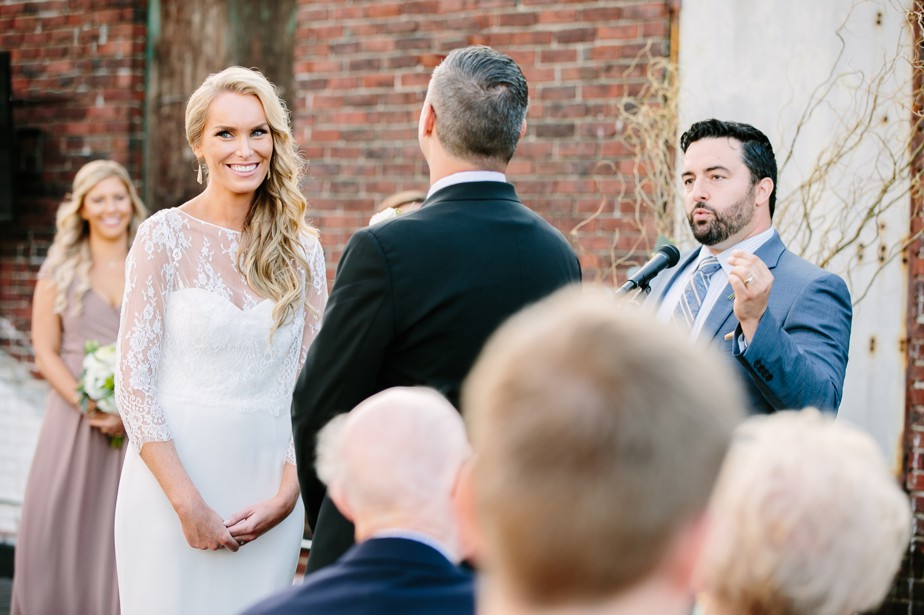 bride smiles at rooftop ceremony at coppersmith boston restaurant wedding