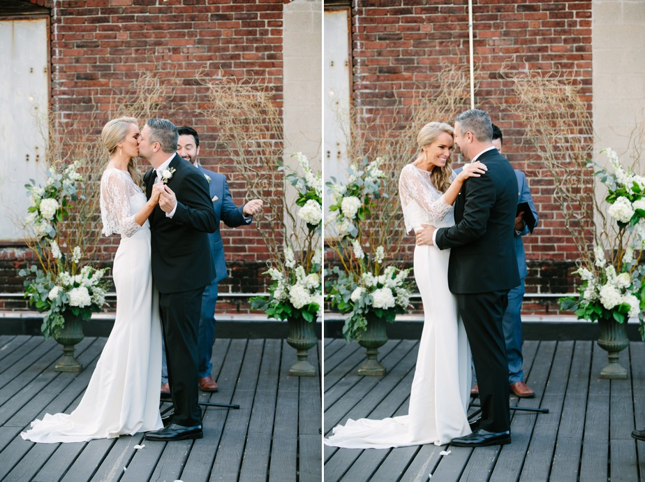 first kiss at rooftop ceremony at coppersmith boston