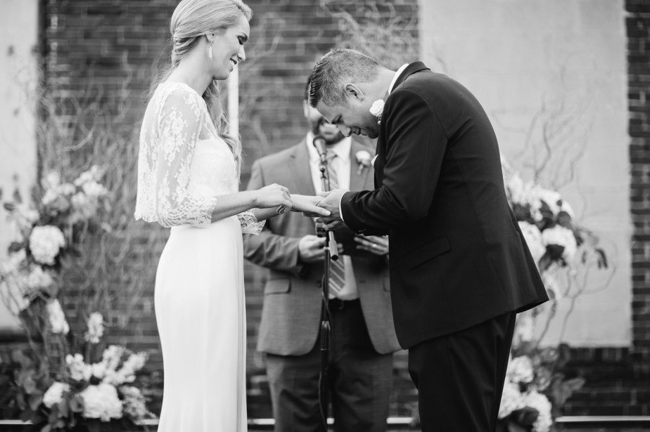 exchanging rings during rooftop ceremony at coppermsith