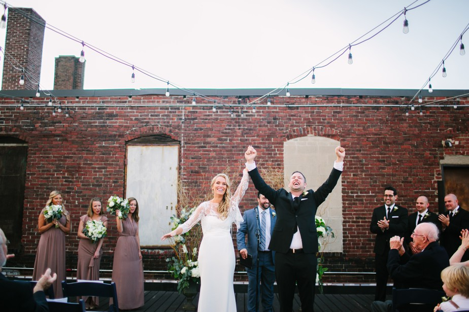 just married at rooftop ceremony at coppersmith boston wedding