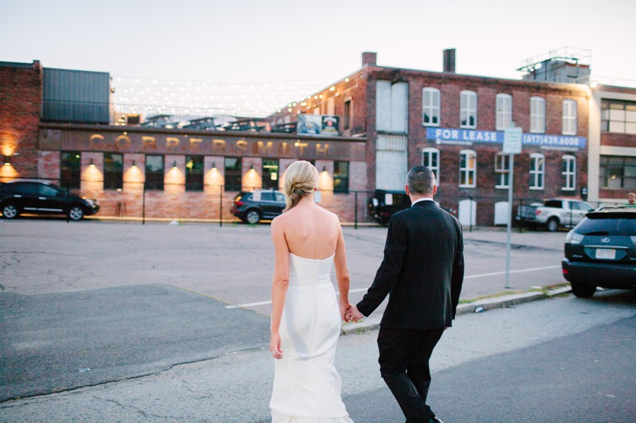 bride and groom take a break from boston restaurant wedding at coppersmith boston