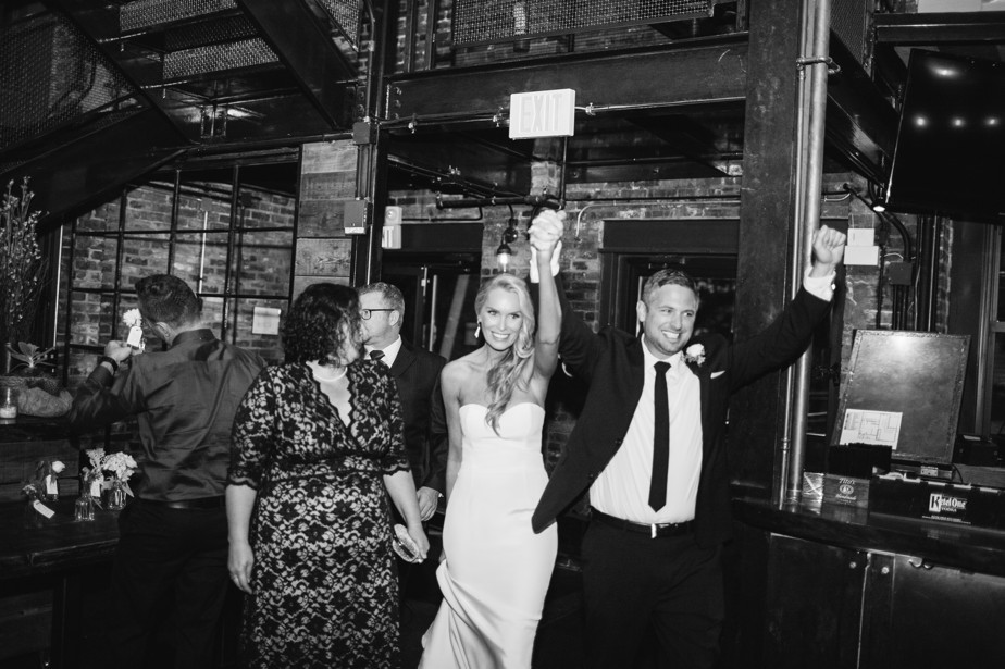 bride and groom announced in at boston restaurant wedding at coppersmith boston