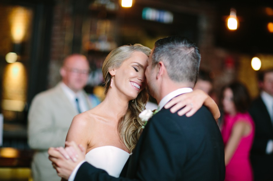bride smiles during first dance boston restaurant wedding at coppersmith boston