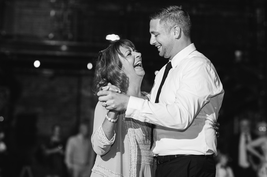 laughing mom during dance at boston restaurant wedding at coppersmith boston