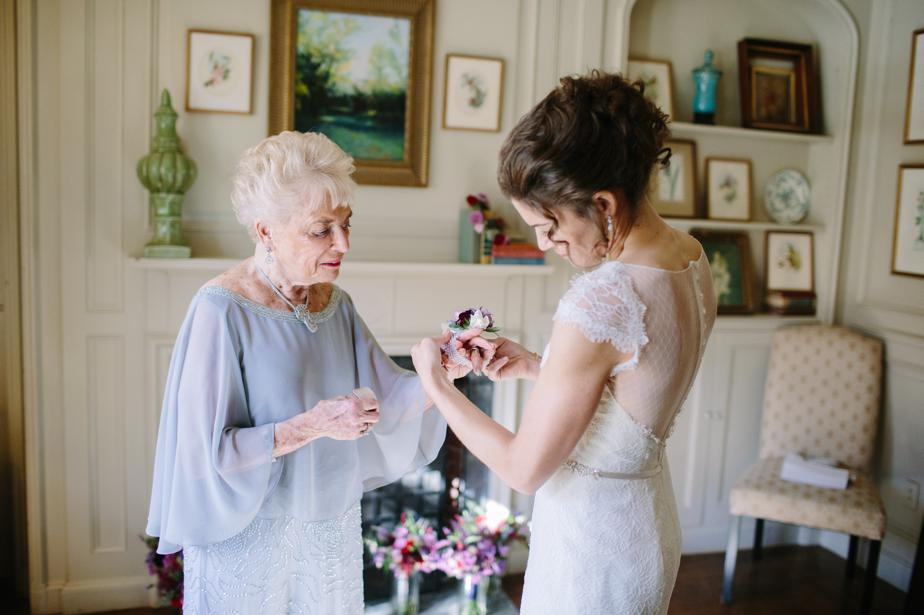gradnmother gets corsage at the estate at moraine farm wedding
