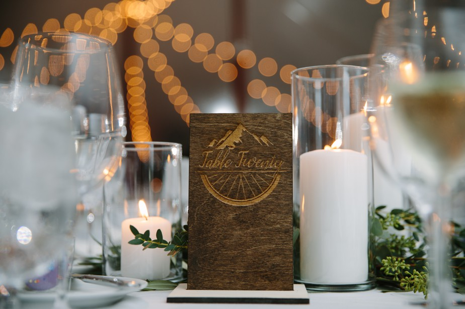 hand etched wooden table numbers at the estate at moraine farm wedding