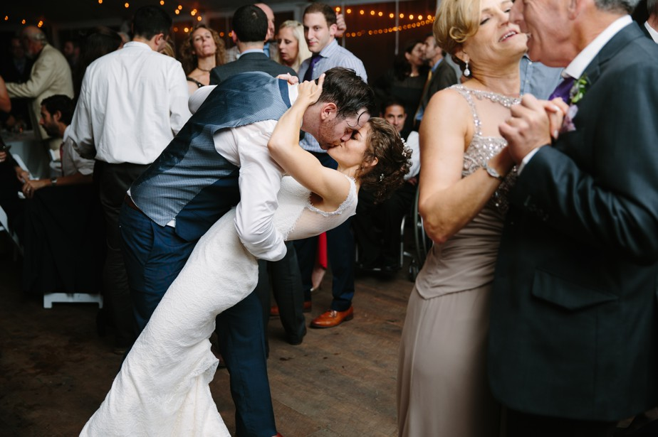 couple dip kiss at the estate at moraine farm wedding