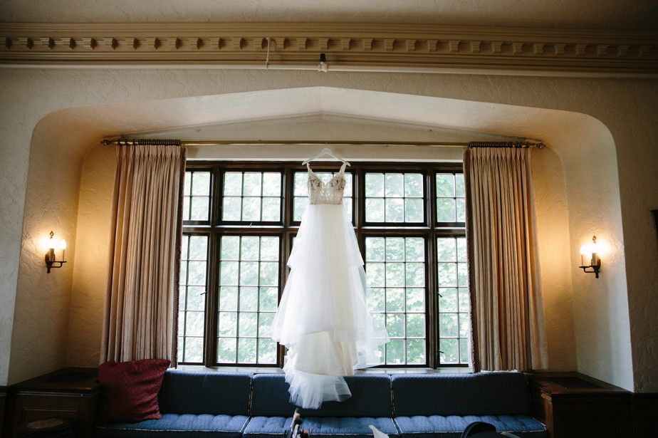 dress hangs at the church for a waterworks museum wedding in Brookline, MA