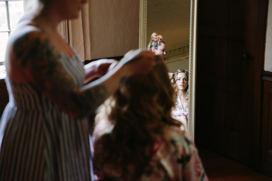 bride gets ready for her waterworks museum wedding in Brookline, MA
