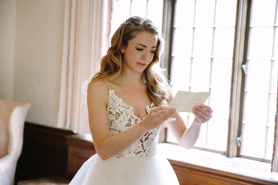 bride gets emotional with card waterworks museum wedding in Brookline, MA