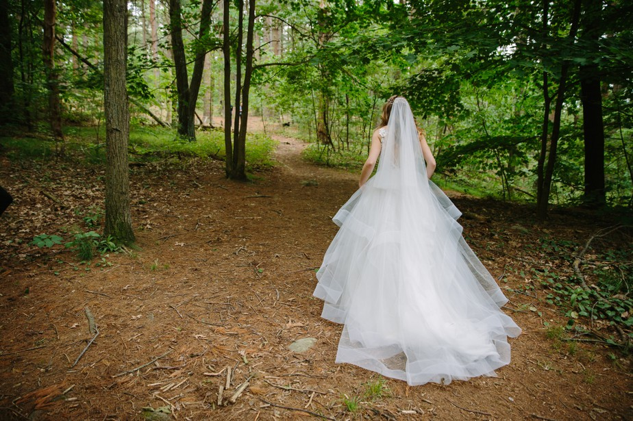 bride walks to first look in the fells winchester waterworks museum wedding in Brookline, MA