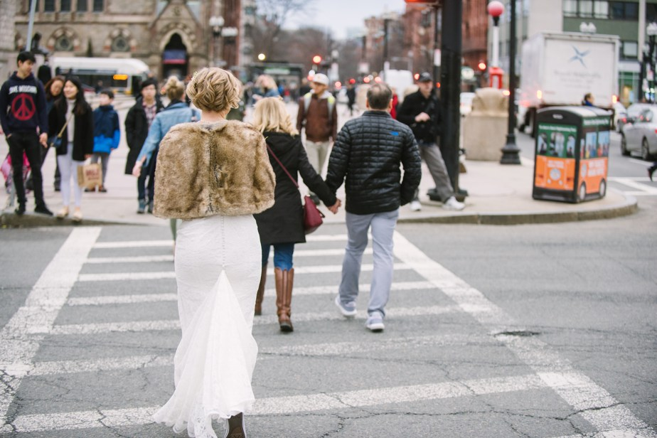 bride walks to boston public library wedding