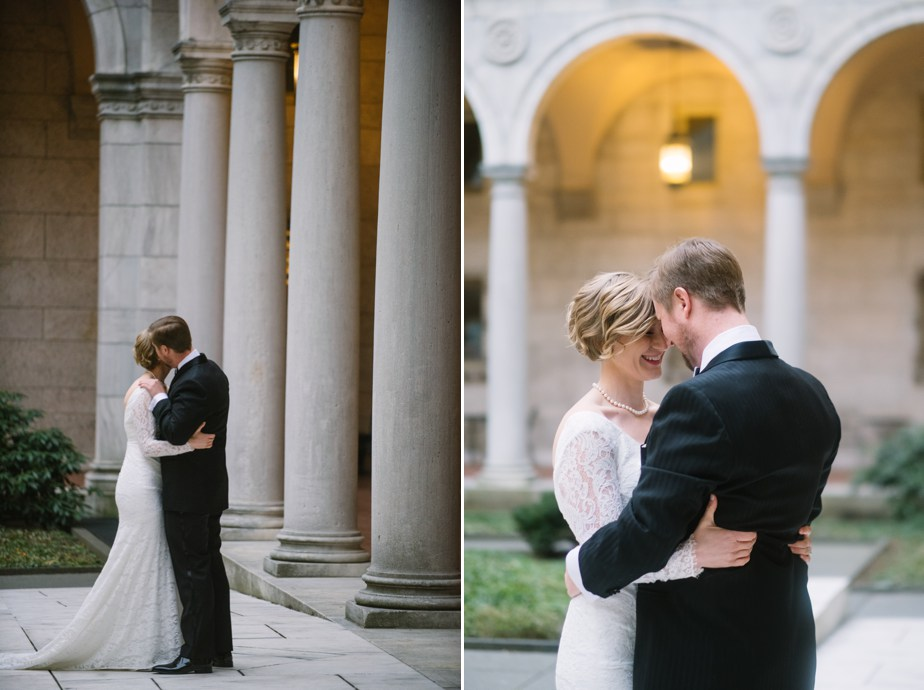 couple embraces in courtyard of boston public library wedding